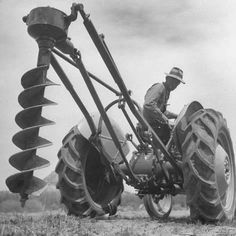 size: Photographic Print: Ford Tractor with Posthole Digger Attachment by Loomis Dean : Artists Antique Tractors, Vintage Tractors, Vintage Farm, Farm Photo, Photo B, 8n Ford Tractor, Farm Paintings, Tractor Implements, John Deere Equipment