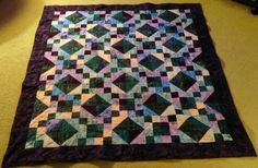 The latest quilt I made. The lighting is bad and you can't see the colors good, but it is super pretty.