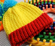 is a must see beginners loom knitting video. This loom knitting tutorial presented by is truly one of the most detailed loom knitting videos for beginners I have seen presented an… Loom Knitting For Beginners, Round Loom Knitting, Loom Knitting Stitches, Spool Knitting, Knifty Knitter, Loom Knitting Projects, Knitting Videos, Baby Knitting, Beginner Crochet