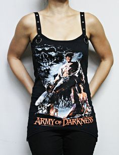 This wicked Army of Darkness top features my signature Strap top tank design. Angled cut Peaks on both sides for an asymetrical cut. Black twill eyelet shoulder straps and d-ring accents. Special Price for a limited time! I am offering Discounts on all Horror merch for multiple purchases. Please contact me if interested.  Available in size Small! Bust: 32-34 inches/ 81-86 cm Waist: Up to 28 inches/ 71 cm  Check out my other Horror Tanks here…