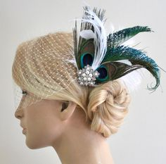 Birdcage veil, peacock feather fascinator