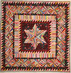 Center Medallion Star with Fans in the Border by Karen Griska