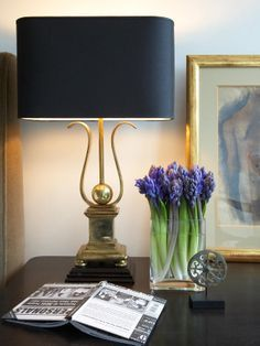 Love the juxtaposition of  the purple hyacinth and the shapely black shaded lamp.
