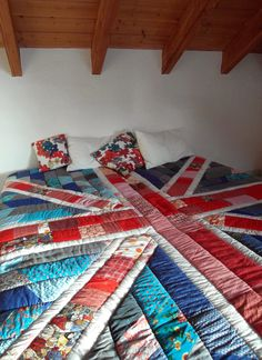 union jack quilt, quilted bed cover. made of old clothings like jeans and shirts plus all those scraps to small for anything.