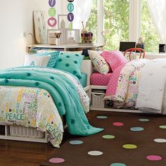 Love the look of these two beds cornered together. Would be fun to do someday for the girls!