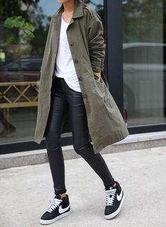 Simple khaki raincoat over white tee and black jeans.