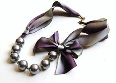 The Original Carrie Necklace in Stormy A silver and purple romantic ribbon and pearl bridesmaid necklace, eggplant, silver, ombré. $25.00, via Etsy.