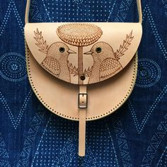 "Santa Fe Satchel ~ Hand stitched leather shoulder bag designed and made by Manolo. Burned decoration drawn by Geninne. Measures 8.5"" x 7.5"" x 1.5"" Natural cowhide finished with wax salve."