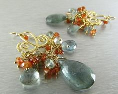Beautiful faceted heishi (tyre cut) Ethiopian opals are stacked on gold filled wire, encased in 22 kt. gold vermeil spacers and gold filled ball beads. the opals are hung from gold filled threaders, which dangle and move to show off flashes of lime green, orange and blue. The threaders measure 3 1/4, but the chains can be pulled up thru your piercing to make them hang as long as youd like. The opals measure approximately 5mm., and the stack measures 3/4 including the beads at each e...