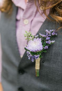 A pale purple boutonniere comprised of lavender and a purple-and-white spider mum by @stevesflowermkt | Brides.com