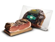 Speck Alto Adige IGP – Is smoked prosciutto, dry-cured and lightly smoked from Italy's Alto Adige. Its garnet color, smoky aroma, and mountain flavors are unmistakable.