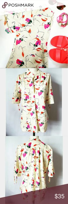"""Vintage Floral Top Such a cutie!! Pullover polyester blouse No size label - approximately size S/M 15.25"""" cross shoulder  19.75"""" front bust  40.25"""" total bust  Single pleat down center front with open V neckline Sleeves can be cuffed and tied up  Very good vintage condition-small fabric flaw on front left under bust (barely noticeable) see additional post for pic  🌟PLEASE READ CLOSET INFO AND POLICIES POST🌟 Vintage  Tops Blouses"""