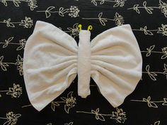 Towel Origami Butterfly from http://foldingmagic.com . Uses one bath towel and one hand towel. Pipe cleaner is optional.