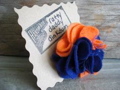 Hey all you Florida Gators fans! Check out this orange and blue felt flower pin! It would great on game day!!!