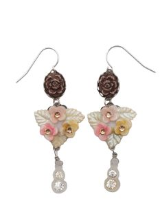 A playful cascade of a taupe resin flower cameo, an ivory glass three-leaf flowered cluster, and dangles of glass and rhinestone beads lend plenty of sparkle to any spring outfit. | April Cornell