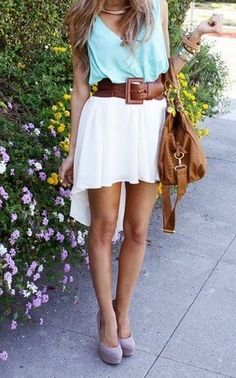 Love this outfit! Beautiful white high low skirt with and wide buckled belt
