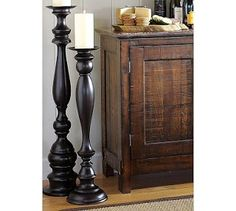 HOW TO MAKE $12 FLOOR CANDLESTICKS... BUY NEWEL POSTS (FOR THE END OF STAIRS) OR BEDPOSTS FROM HOME DEPOT, CUT TO SIZE, PLACE IN FENCE POST TOPPERS (ONES WITH A FLAT TOP) - MAKING SURE THEY ARE LEVEL, AND THEN SPRAY PAINT THEM