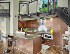 Love the idea of having a loft over the kitchen like this.