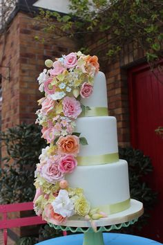 """My demo Wedding Cake on dummies, flowers are a mix of roses hydrangea, stephanoites and gardenias,from """"Tipperary Cooking Club"""" I hope like it :)"""