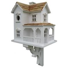 Birdhouse Construction Material: Ply-board and polyresinColor: WhiteFeatures:  Classic rocking chair porch, window and door moldings and a pine shingled roofComes equipped with a mounting bracket to be able to put the house on a post or tree or a fence1.25 Opening will allow wrens, finches, chickadees and nuthatches to nest Dimensions: 12 H x 10 W x 14 D
