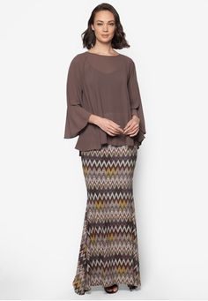 Midi Kedah Printed Kurung from Zuco Fashion in Brown Inspired by the timeless Kedah Kurung design, Zuco Fashion manage with infuse this local favourite with a sense of urban appeal into this gorgeous creation. The sheer polyester top is nicely contrasted with the homely prints on the bottom skirt&#... #bajukurung #bajukurungmoden