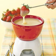 White Chocolate Fondue for New Years eve game night.   Use strawberries, pretzels, pound cake and marshmallows to dip