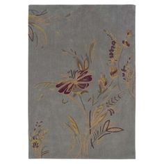 Hand-tufted rug with a floral motif.  Product: RugConstruction Material: 100% PolyesterColor: Pl...