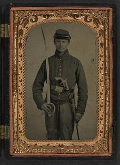 [Unidentified young soldier in Union artillery uniform with artillery saber and revolver]