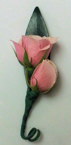 pink boutonniere featuring sweetheart roses, perfect for a ring bearer