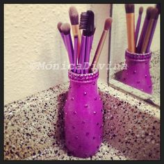 Makeup brush holder made by me :)     (Starbuck's Frapuccino bottle, purple and pink acrylic paint, spray-on glitter and rhinestone stickers)