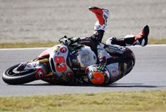 Kalex Moto2 rider Esteve Rabat of Spain falls during a free practice session for Sunday's Japanese Grand Prix at the Twin Ring Motegi circuit in Motegi, north of Tokyo October 11, 2014. Rabat won the pole position for Sunday's Japanese Grand Prix at a qualifying session. REUTERS-Toru Hanai