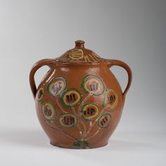 PENNSYLVANIA SLIP-DECORATED REDWARE JAR AND COVER, BUCKS COUNTY, 1780-1820.