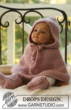 "Knitted DROPS poncho with hood and booties in ""Eskimo""."