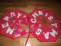 Handmade Christmas bunting with red polka dot fabric and Cath Kidston Christmas birds fabric with 'MERRY CHRISTMAS' applique - Breifne Cottage Designs