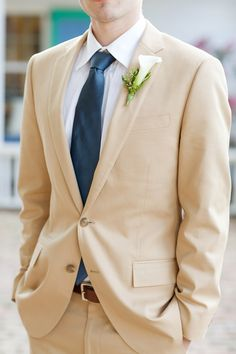 tan suits - different shades of blue ties to match the girls dresses