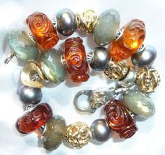 ambers and labs! Wow -from a collector on Trollbeads Gallery Forum.  Stunning natural beauty.