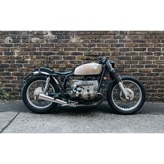 """From Harley to BMW — my beloved shovelhead gets a new owner and I wanted a new ride. BMW wasn't really my favorite at first glance, but after some days of research I found a nice beamer — my first BMW ever. The R75/5 was in good conditions and ready to ride. It inspires me a lot and I did some """"quick"""" changes and modifieds to realize my ideas. The front fork and shocks are lowered, the original tail frame is modified with an upsweep, a new rear fender, a solo seat and pillon pad, complete…"""