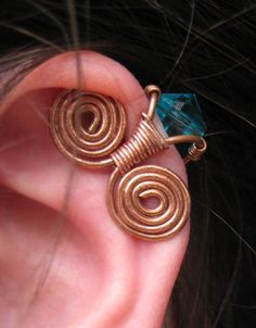 Steampunk Ear Cuff, Copper Wire Wrapped Ear Cuff, with Turquoise Swarovski Crystal. $10.90, via Etsy.