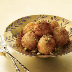 Fried Goat Cheese Balls with Honey // More Cocktail Party Recipes: http://www.foodandwine.com/slideshows/cocktail-party #foodandwine