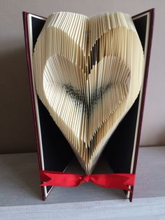 A personal favourite from my Etsy shop https://www.etsy.com/uk/listing/386183796/heart-outline-book-folding-pattern