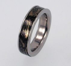 Titanium and Mokume Gane Ring - Thin Width Band - jer1-005. $249.00, via Etsy. (I love these Mokume Gane rings because they're using the same process that was once used to make swords.)