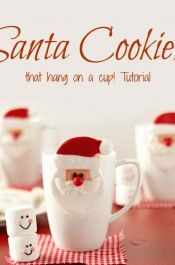 Santa Cookies that hang on a cup Decorated Christmas Cookies via www.thebearfootbaker.com