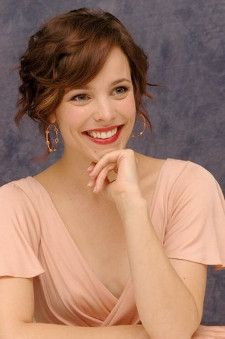 Actress Rachel McAdams with brunette hair in a peach color dress
