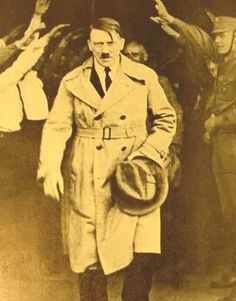 Adolf Hitler exiting Brown House after successful election 1930