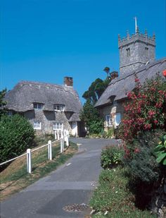 The beautiful village of Godshill, Isle of Wight, England, and the medieval church of All Saints and St. Lawrence.