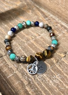 Excited to share this item from my #etsy shop: Peace & Flower Bracelet. Womens Bracelet/Gift. BOHO Bracelet. Boho Chic. Good Vibes #blue #yellow #no #unisexadults #bohohippie #peacesignbracelet #metalstamped #flower #bohochic Cute Bracelets, Beaded Bracelets, Hand Stamped Metal, Hippie Boho, Bohemian, Flower Bracelet, Metal Flowers, Metal Stamping, Bracelet Making