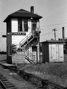 """This close up view of the tower was taken on August 21, 1961, looking east. The operator's platform was located on the second floor while the mechanical """"guts"""" of the interlocking machine took up most of the first floor. Prior to the 1937 merger of the DM&N and D&IR the name of this tower was West DM&N Junction. (Image: C.F. Sager, Twin Ports Rail History Collection)"""