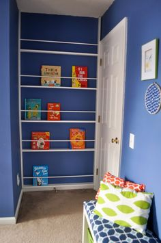 DIY Behind the Door Bookshelf- this would be awesome in my sons room to save space!