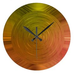 Almost as beautiful as the rising, morning sun, this metallic gold and rose-gold tone wall clock will illuminate any room and add a touch of fine art wherever it helps you keep track of the passing hours.  Designed for you by graphic icon artist, photographer, Joyce Dade.  Other colors are available in the Joyce Dade Art store here on Zazzle.  A lovely gift of time for new homeowners and all others who want something stylish and up to the minute in every way.  Your purchase is appreciated…