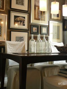 Glass/matting/framed/ staged art work adds ambiance + eye candy to a gathering space. Note*  vintage glass bottle collection adds reflective ambiance!